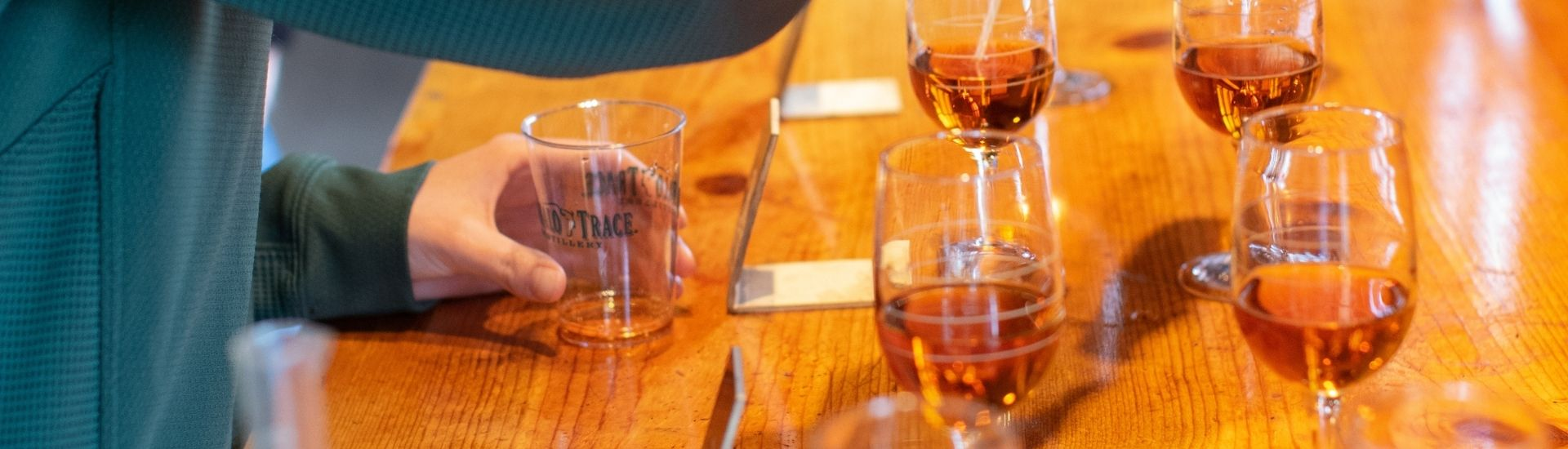 Filling glasses with buffalo trace bourbon