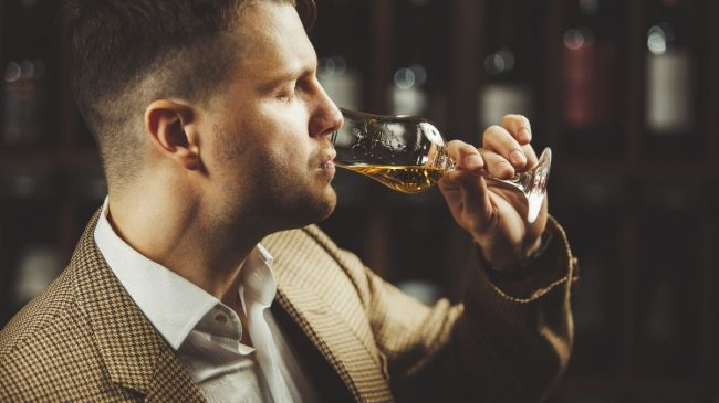 Whiskey tasted by man