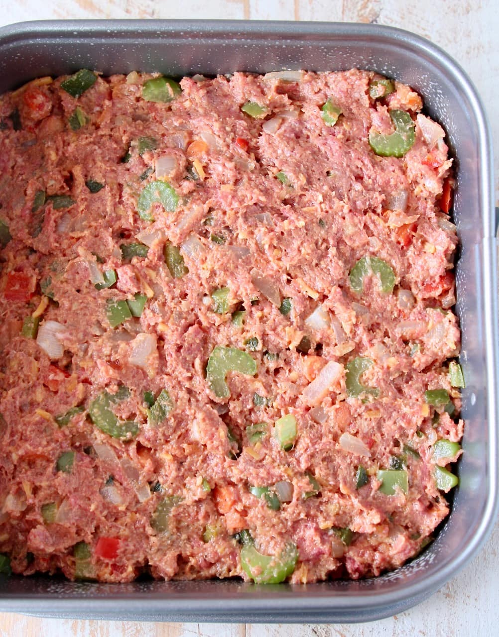 Uncooked mexican meatloaf in square springform pan