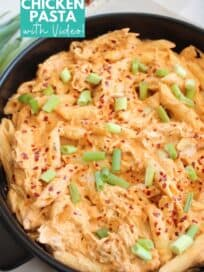 Penne pasta in cheesy buffalo chicken sauce in pan