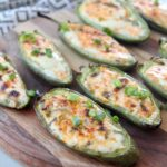 grilled jalapeno poppers on wood cutting board