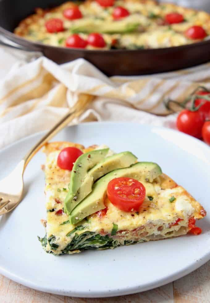 Slice of frittata on plate with fork