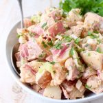 Traditional potato salad is given a spicy twist with the addition of buffalo sauce in this vegetarian and gluten free buffalo potato salad recipe!