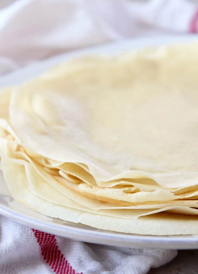 crepes stacked on top of each other on a plate