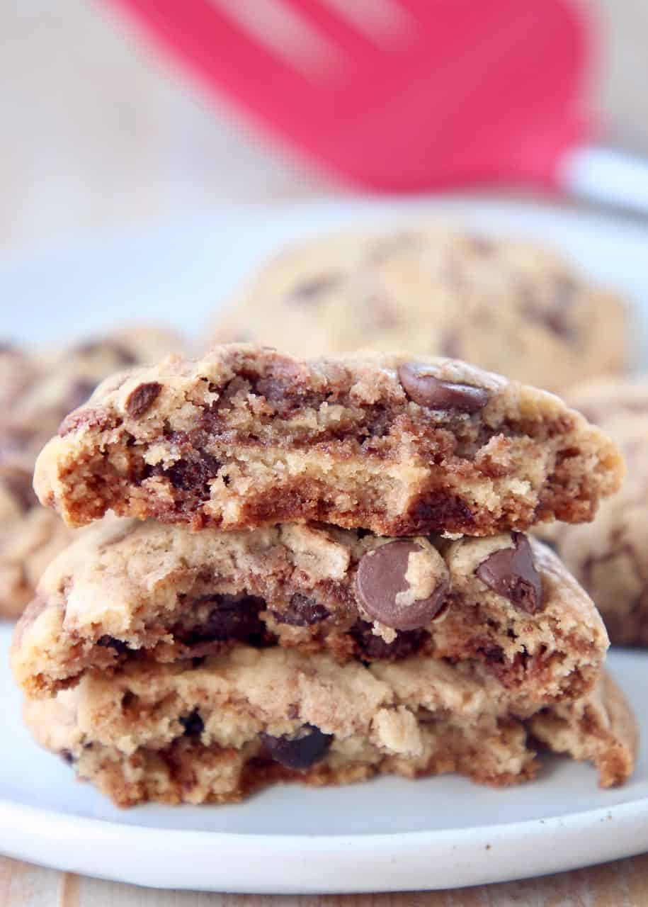 Nutella chocolate chip cookies broken in half and stacked on top of each other