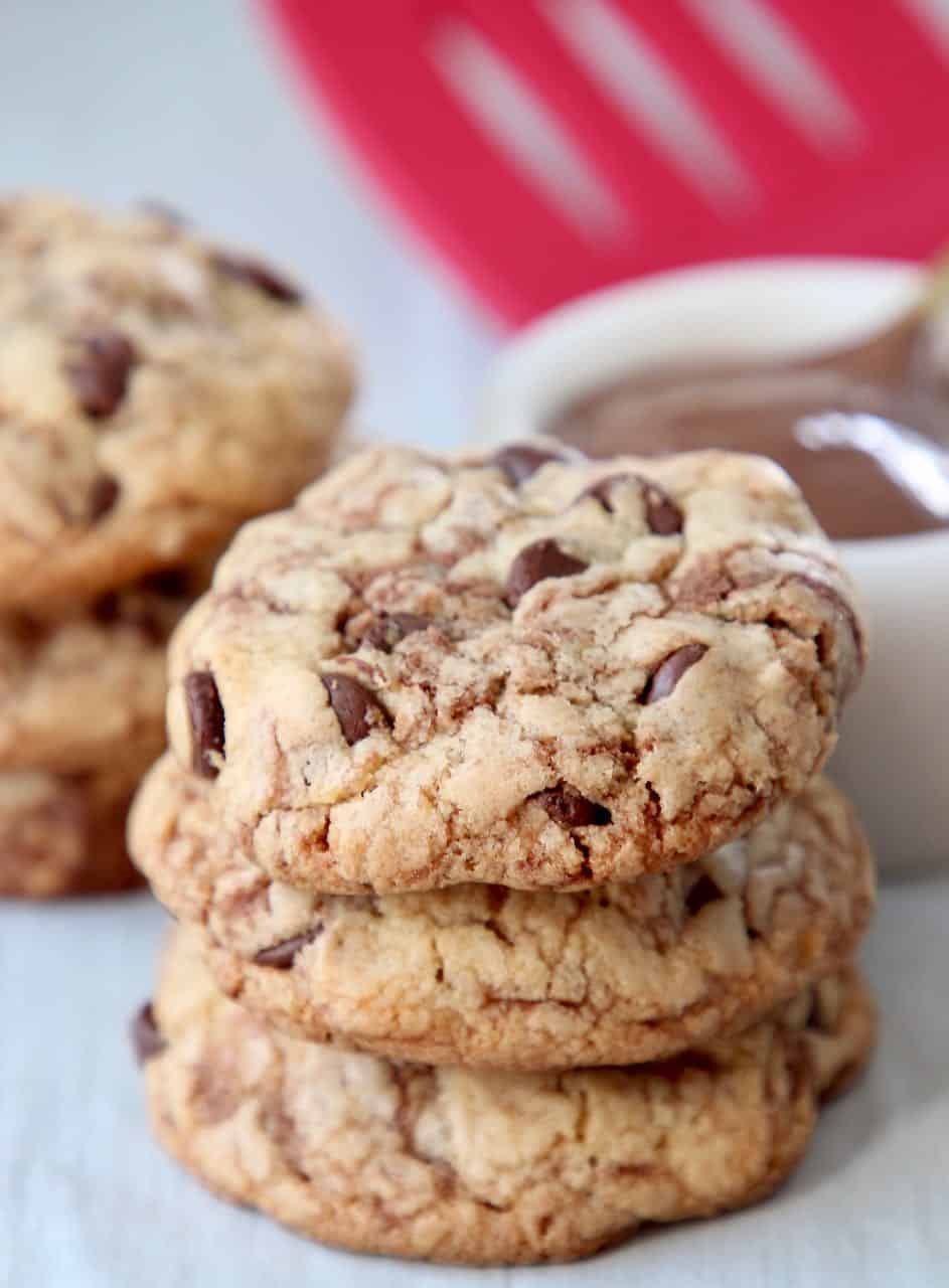 Stacked nutella chocolate chip cookies on plate