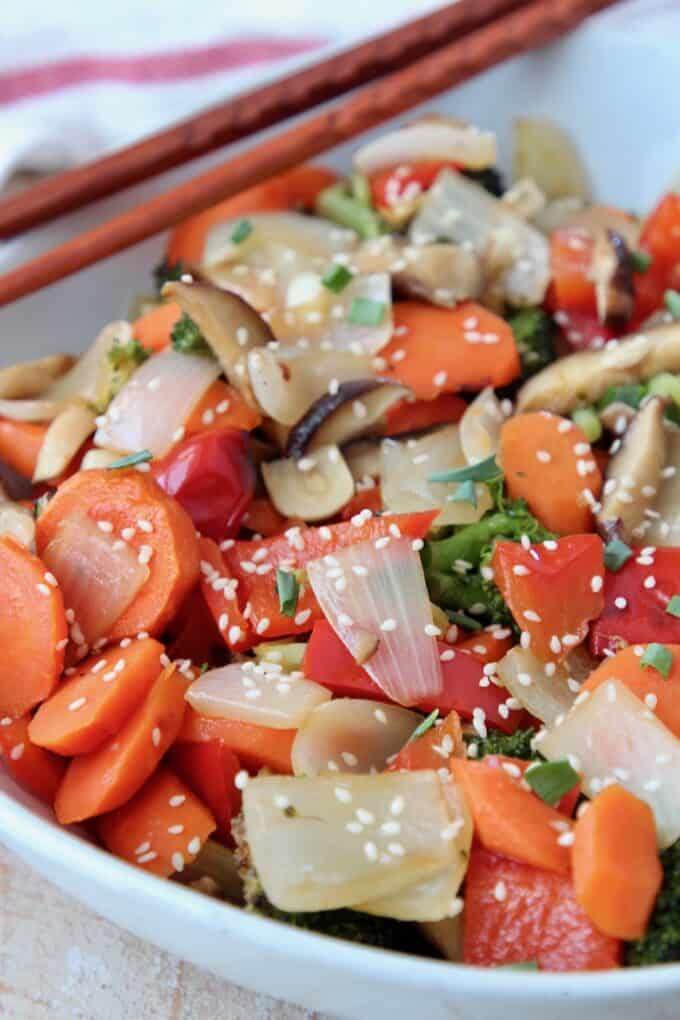 roasted vegetables in bowl with chopsticks