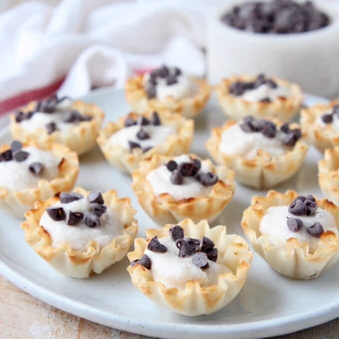 mini cannoli cups topped with mini chocolate chips on plate