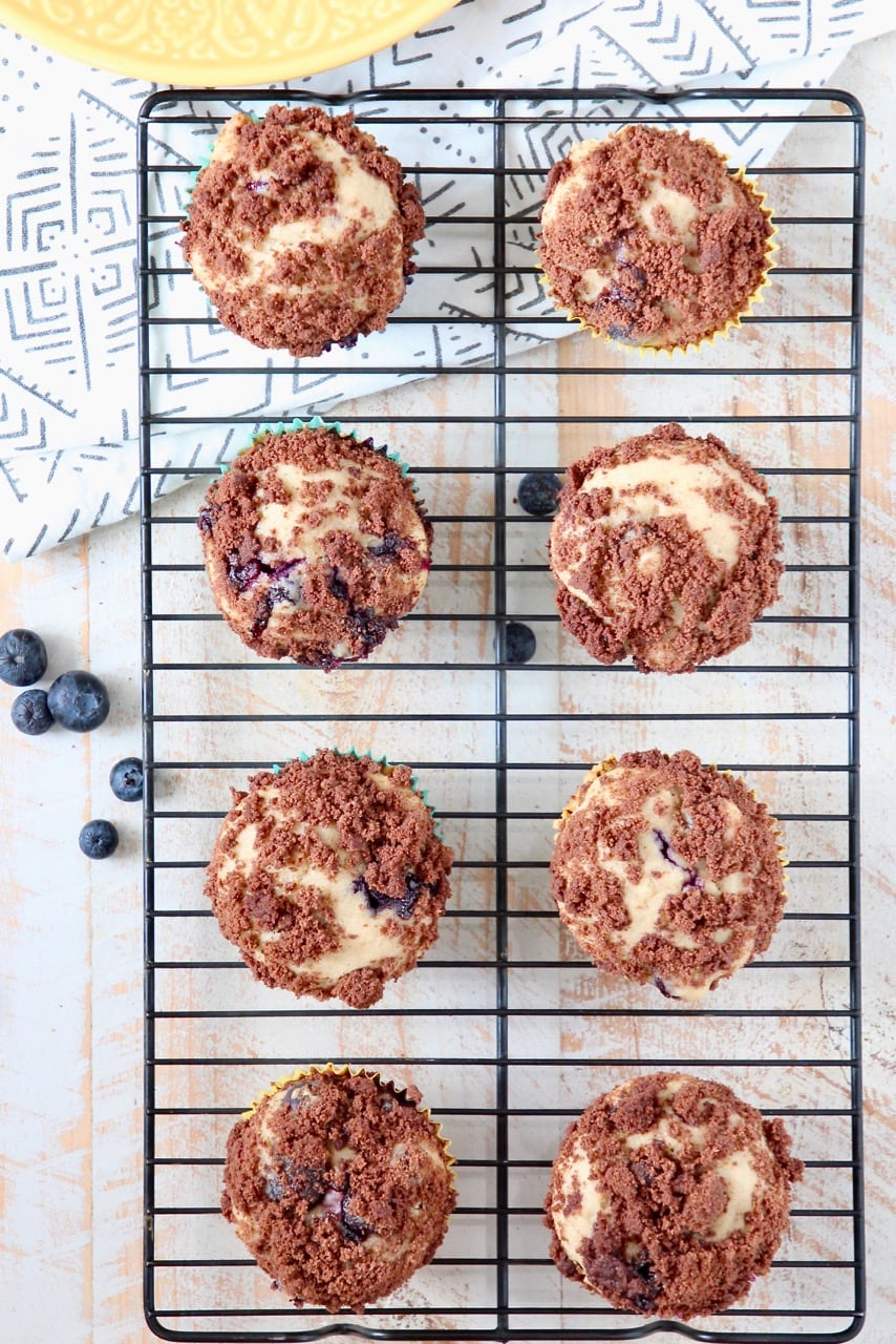 Blueberry Cream Cheese Muffins with Chocolate Crumble on Wire Baking Rack
