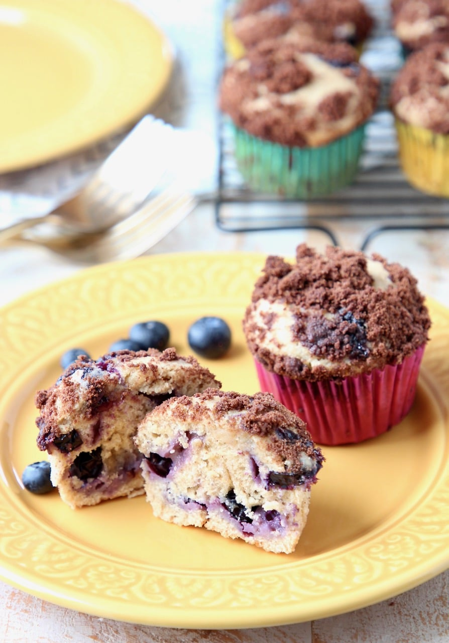 Blueberry Cream Cheese Muffins with Fresh Blueberries on Yellow Plate