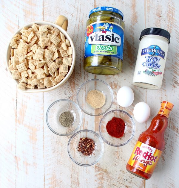 Pickle Chips are dipped in buffalo sauce, then rolled in a spicy Rice Chex mixture and baked golden brown for the perfect gluten-free & vegetarian snack!