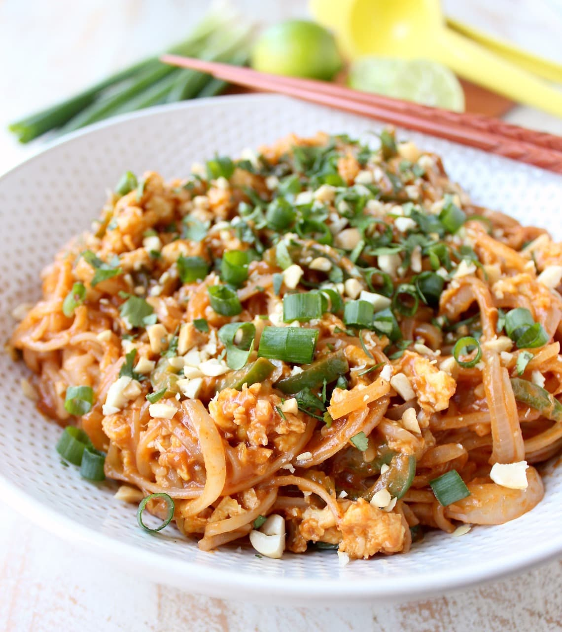 Pad Thai Recipe in bowl with eggs, green onions and peanuts