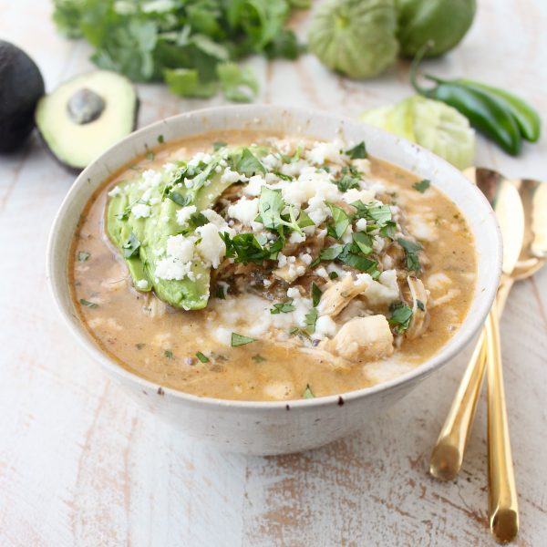This flavorful Green Chili Chicken Enchilada Soup made with roasted chilies, tomatillos, fresh herbs & chicken is sure to be your new favorite soup recipe!