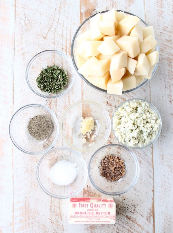 Warm rosemary herb infused butter is added to these blue cheese mashed potatoes for the best potato side dish you'll ever have in your life!