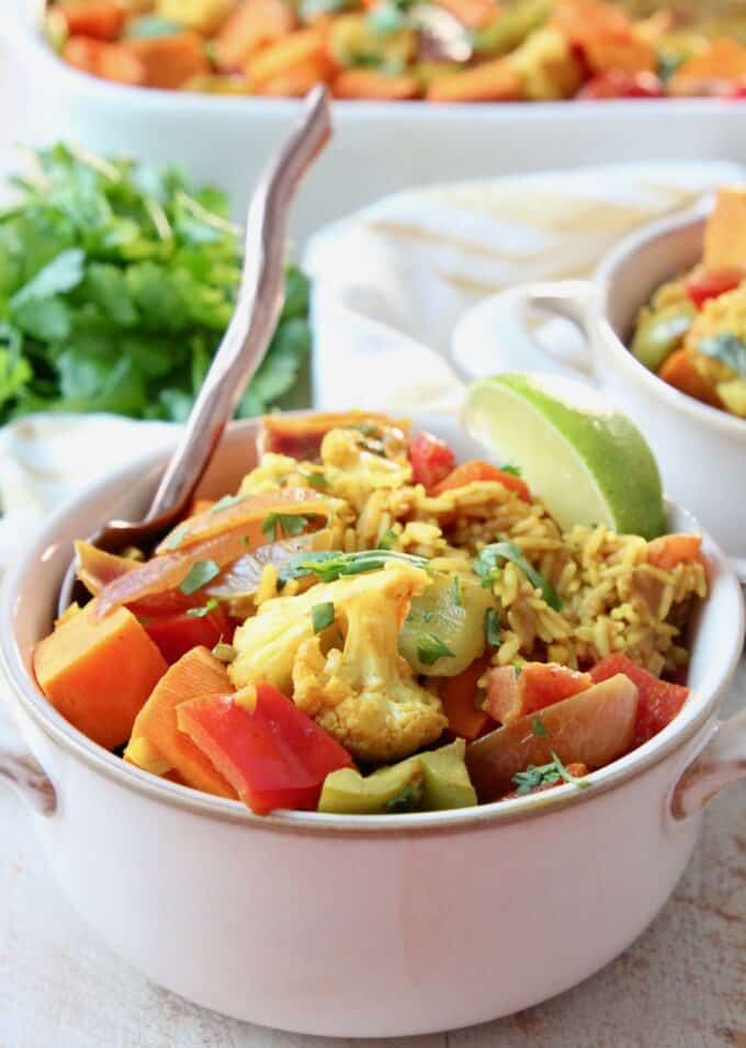 curry casserole with vegetables and rice in bowl with fork