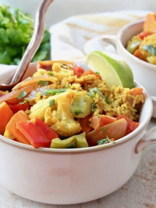 curry casserole in bowls with fork