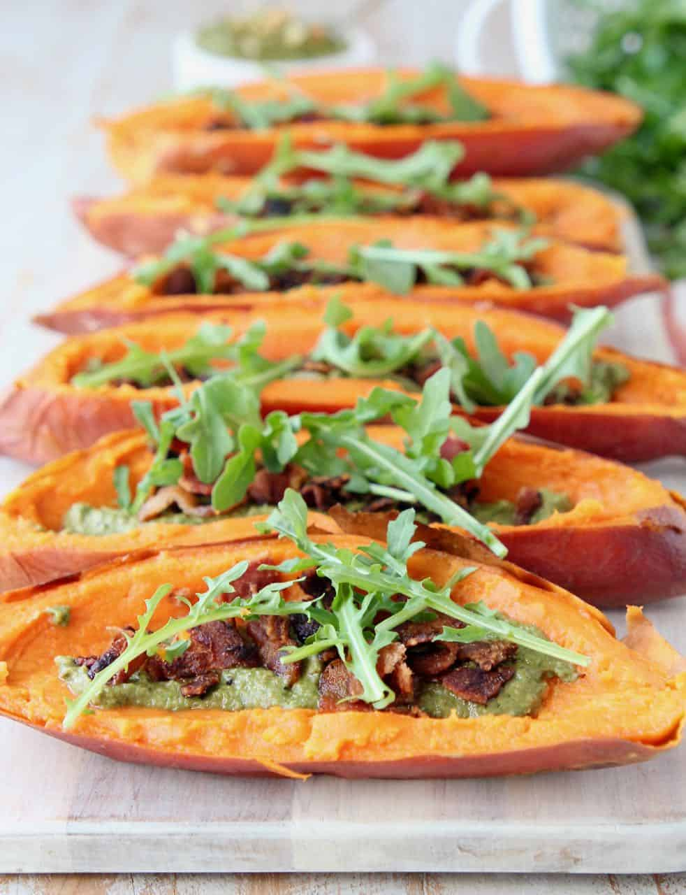 Loaded sweet potato skins on wood serving tray