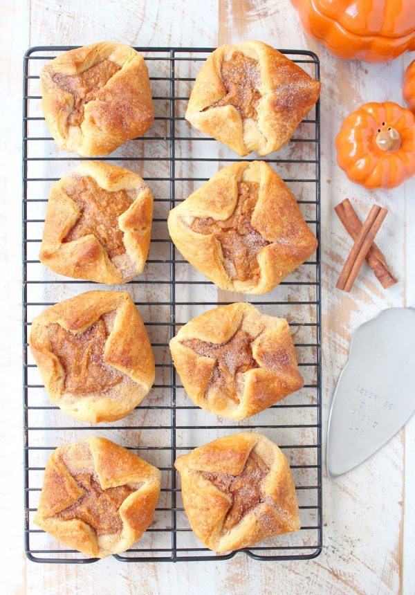 pumpkin filled pastries on wire baking rack