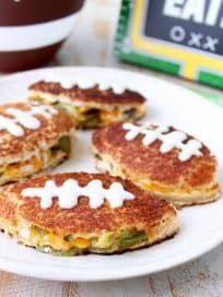 Jalapeno popper grilled cheese sandwiches in the shape of a football