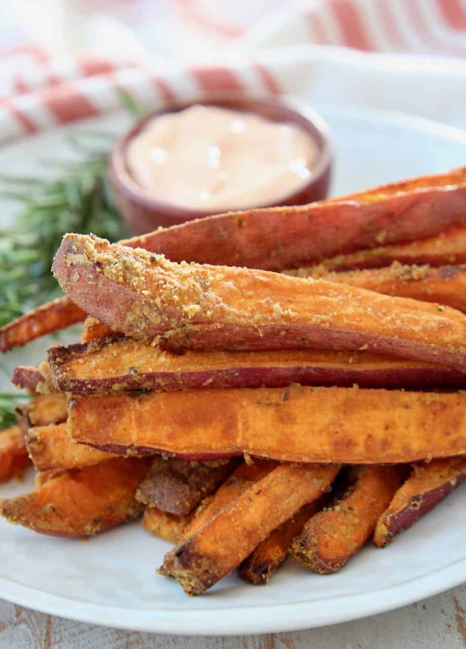 Sweet potato fries stacked up on plate