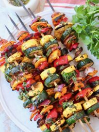grilled vegetables on skewers on white plate