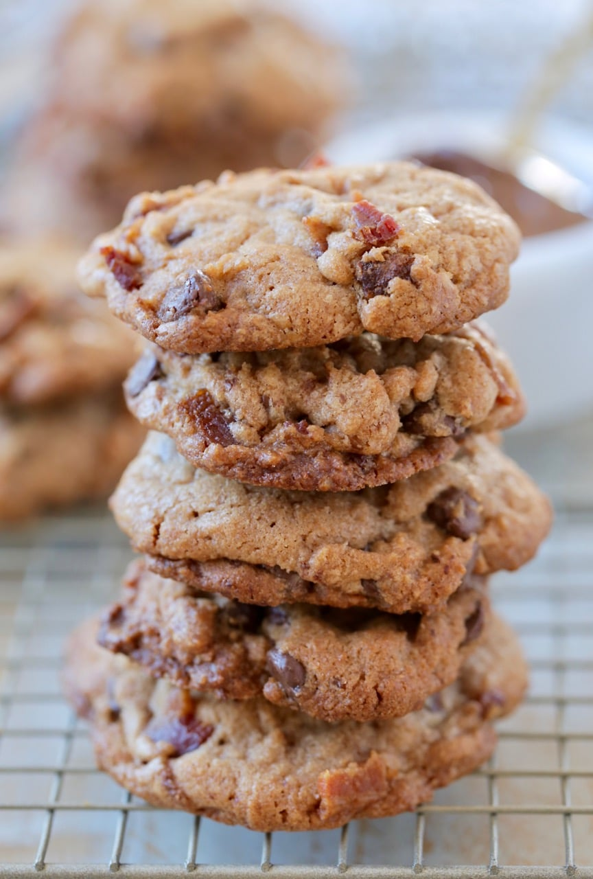Stacked up bacon chocolate chip cookies on wire rack