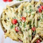 Close up of taco pasta with cherry tomatoes in a casserole dish