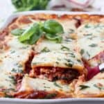 slice of vegetable lasagna being lifted out of casserole dish