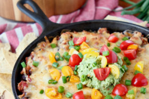 The Best Cheesy Baked Taco Dip, image with text overlay