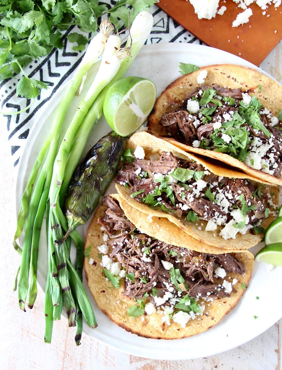 Slow Cooker Shredded Beef Barbacoa Tacos in Corn Tortillas with Grilled Green Onions, Jalapeno and Lime