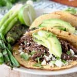 Slow Cooker Shredded Beef Barbacoa Tacos with Avocado, Cotija Cheese and Cilantro