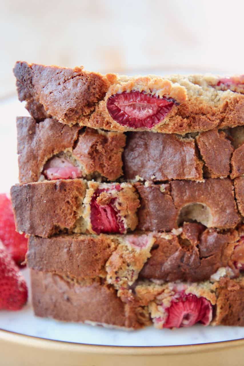 Stacked up pieces of strawberry banana bread
