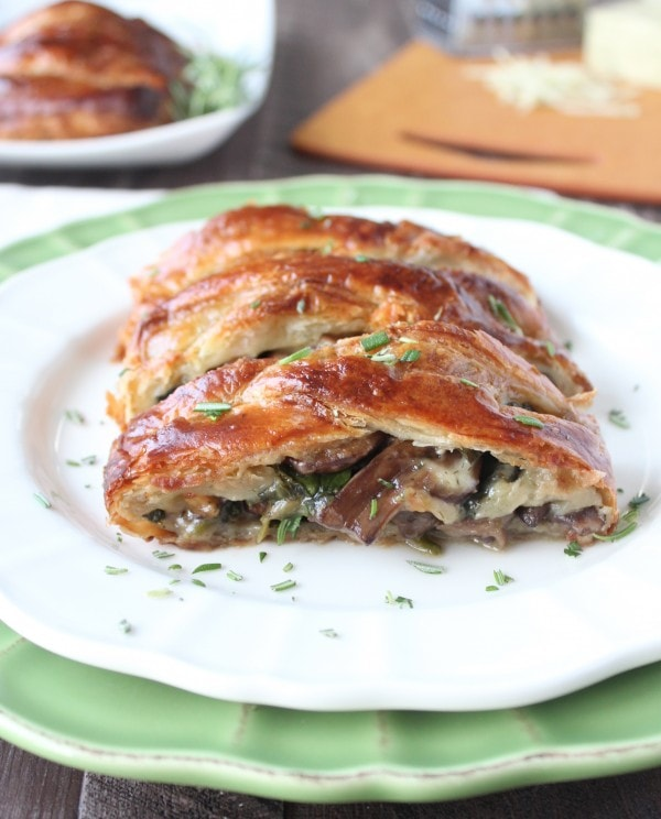 This vegetarian spinach puff pastry recipe is filled with sauteed mushrooms, spinach, and cheddar cheese. Perfect as an appetizer or meatless Monday dinner!