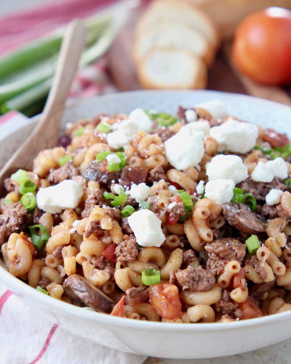 Ground lamb pasta in bowl topped with crumbled feta cheese