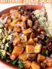 Roasted butternut squash salad in bowl with dates and quinoa