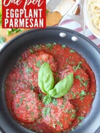 Overhead image of eggplant parmesan in skillet with sauce