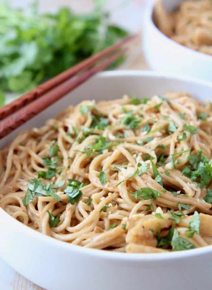 noodles in bowl topped with chopped fresh cilantro