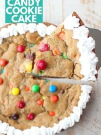 candy cookie cake with slice lifted out of the cake