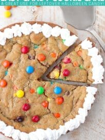 candy cookie cake with slice taken out of the cake