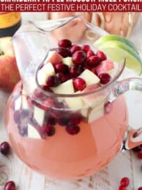 Moscow mule punch with diced apples and cranberries in glass pitcher