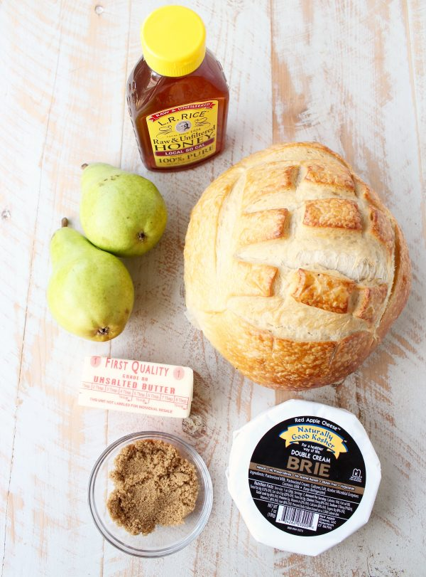 Baked brie sourdough bread bowl ingredients, honey, pears, butter, brie, sourdough and brown sugar