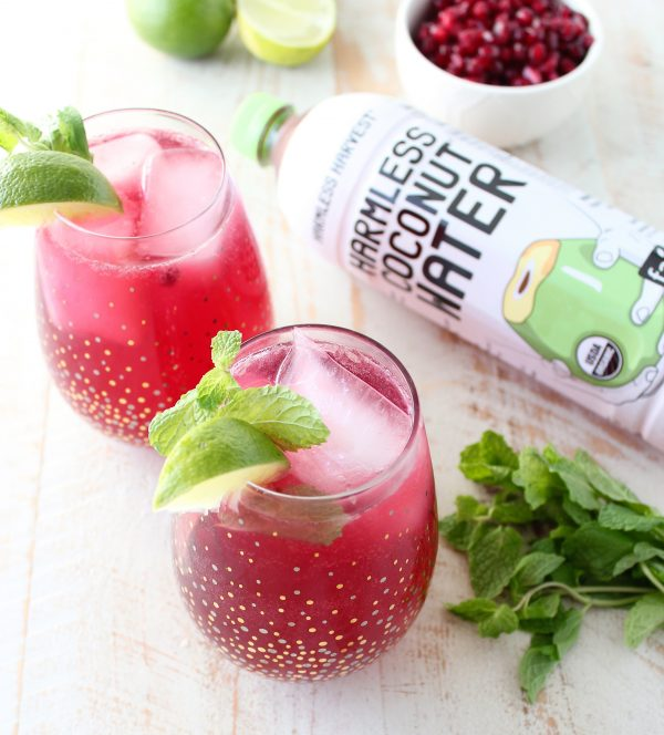 Sparkling pomegranate soda & coconut water are added to this mojito punch recipe, perfect for celebrating everything from holiday parties to Summer BBQ's!