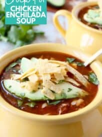 soup in yellow bowl topped with sliced avocado and tortilla strips