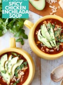 Overhead image of enchilada soup in yellow bowls topped with sliced avocado