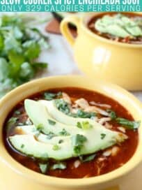 enchilada soup in yellow bowl topped with sliced avocado