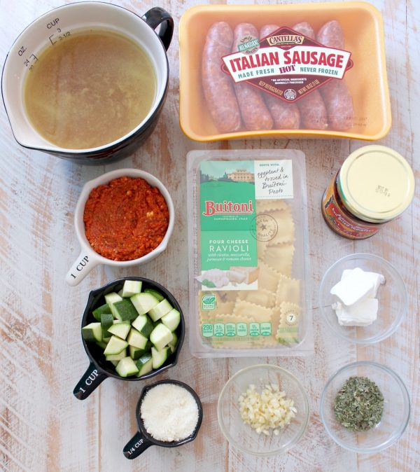 One Pot Ravioli with Creamy Pesto Sauce & Sausage is an absolutely mouth watering, delicious recipe that is so easy to make in only 20 minutes!