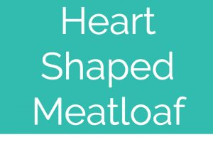 """Heart shaped meatloaf on white square plate topped with heart shaped spinach leaves with text overlay """"heart shaped meatloaf WhitneyBond.com"""""""
