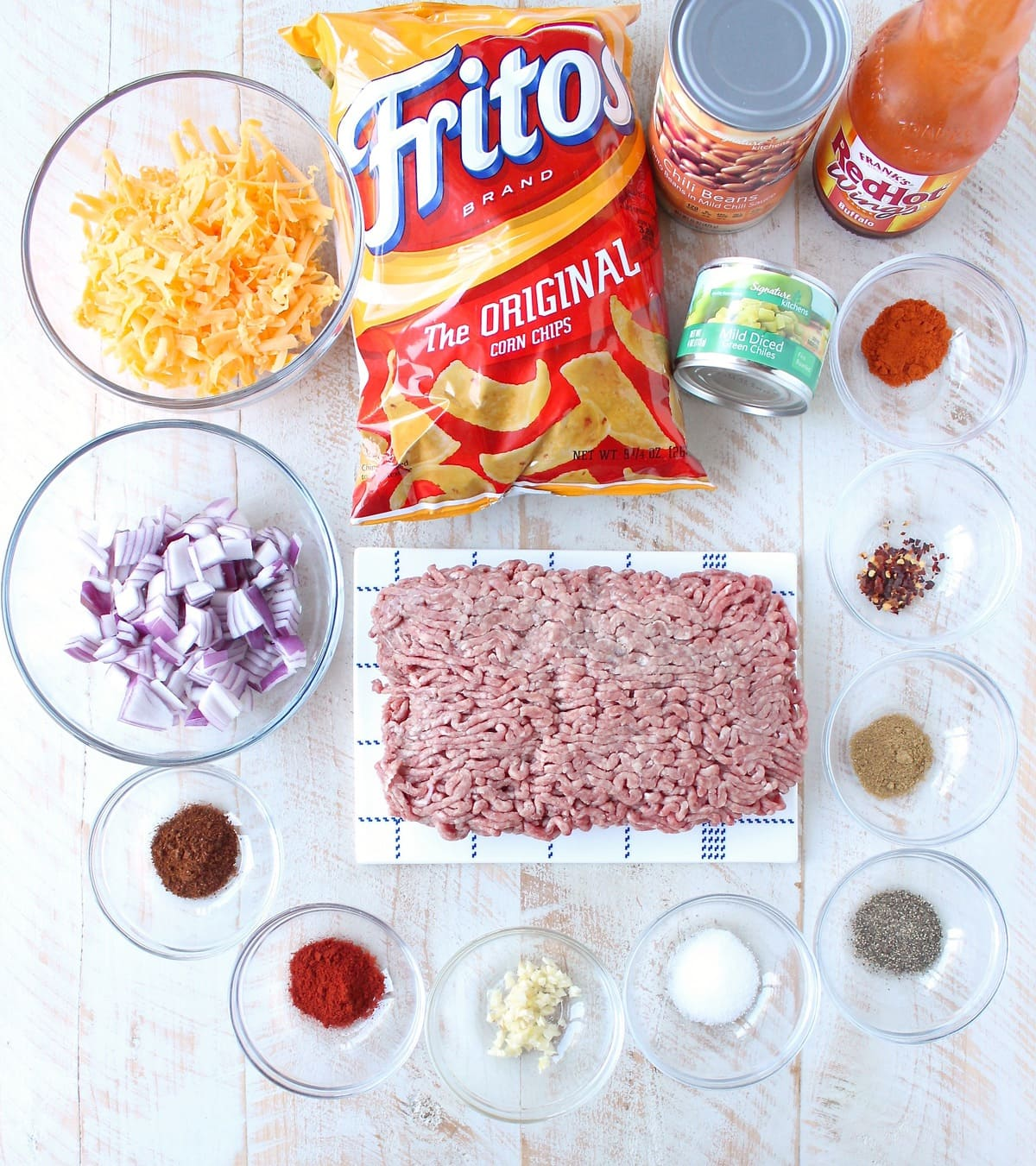 Frito Chili Pie is given a spicy kick with the addition of buffalo sauce, green chilies and spices in this delicious twist on a classic recipe, easy to make in only 20 minutes!