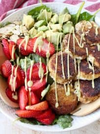 Crispy goat cheese, creamy avocado & juicy strawberries top spinach & arugula, tossed with avocado vinaigrette, for the perfect vegetarian Spring salad!