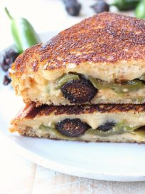 Roasted jalapeños, dried figs and spicy cheddar cheese are combined in this delicious, sweet and spicy, vegetarian jalapeno grilled cheese sandwich recipe!